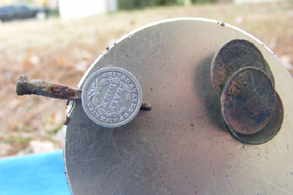 1839 Half-Dime fused to an iron nail
